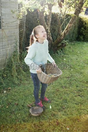 girl holding basket in garden