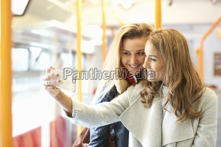 two young female friends on train