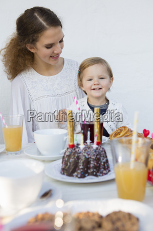 teenage girl and toddler at patio