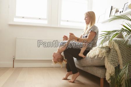 mid adult woman sitting on sofa