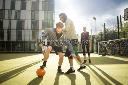 group of adults playing football on