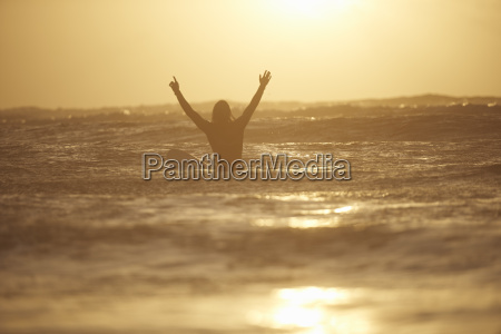silhouette of young male surfer with