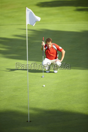 front view of golfer crouching down