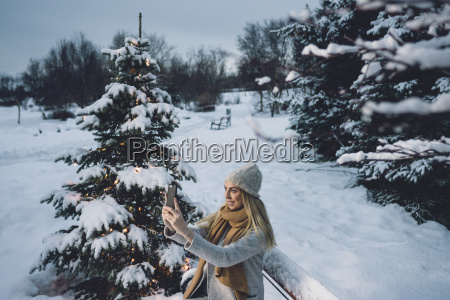 young woman wearing woollen hat and