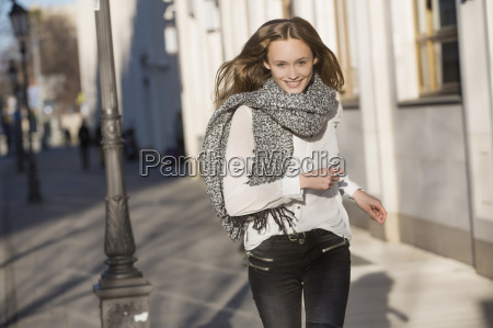 portrait of mid adult woman running