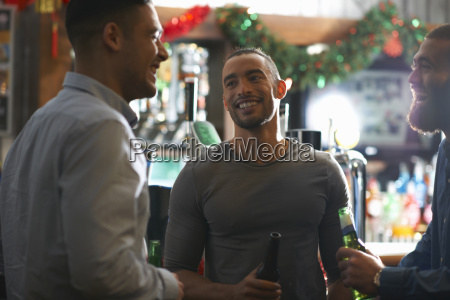young man in public house holding