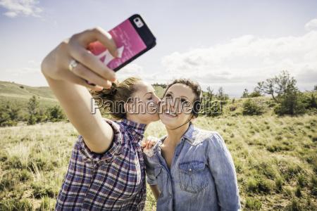 two young women taking smartphone selfie