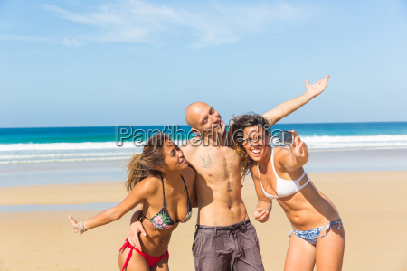 man and two young women wearing