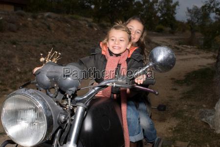 girls riding an old bike