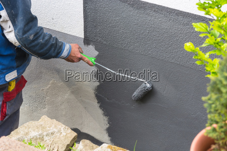 painter with paint roller in hand