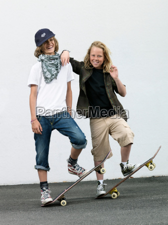 two boys with skateboards
