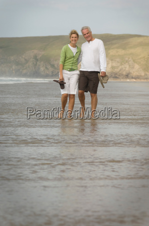 couple walking arm in arm on