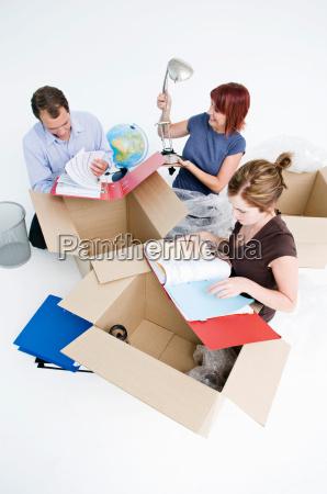 business colleagues unpack office boxes