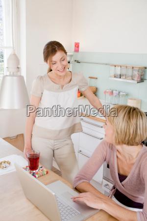 women in kitchen talking