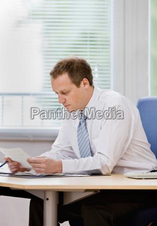 man working on paperwork