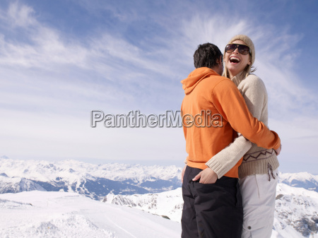 couple hugging and laughing
