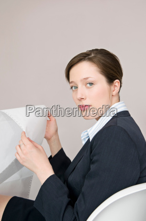 a business female holding computer paper