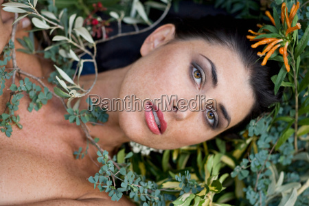 headshot of a female with plants