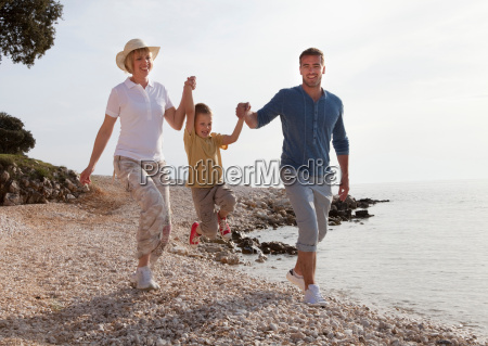 family with jumping son at the