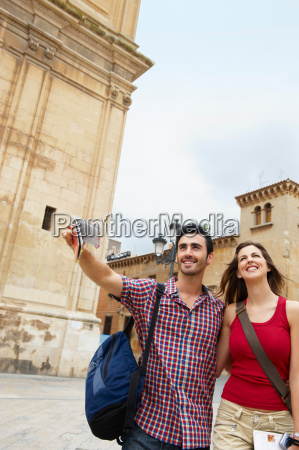 tourist couple in old city square