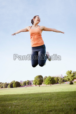 woman jumping in park