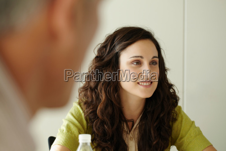 portrait of young woman in meeting