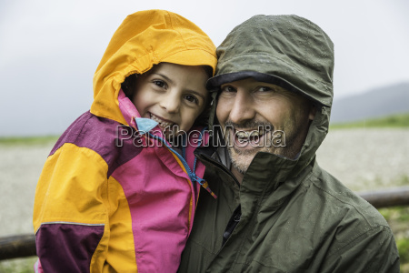 father and daughter in rainproof jackets