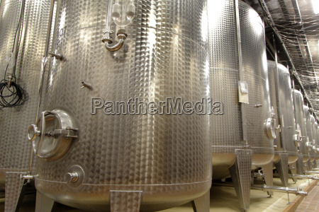 stainless steel vats on industrial wine