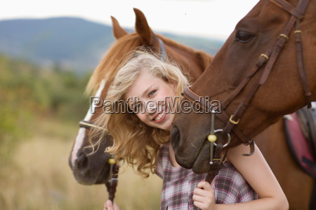 young woman and horses