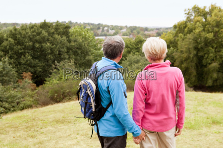 mature couple looking out over valley