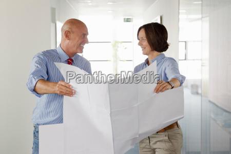 business people examining blueprints