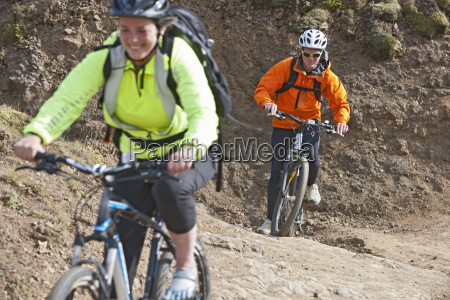 close up of mountain bikers cycling