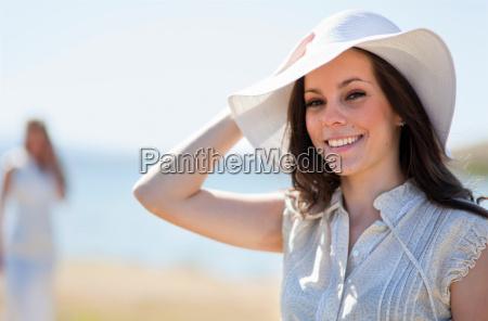 smiling woman wearing sunhat