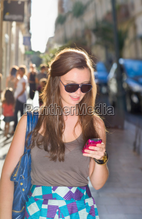 young woman check cell phone in