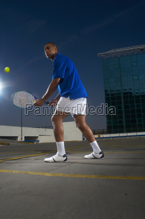 tennis player on rooftop court