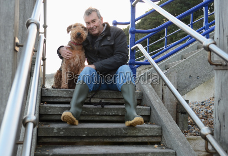 portrait of senior man with dog