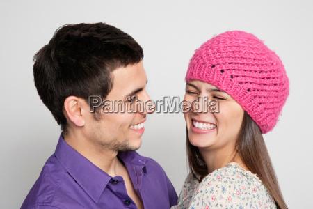laughing couple hugging