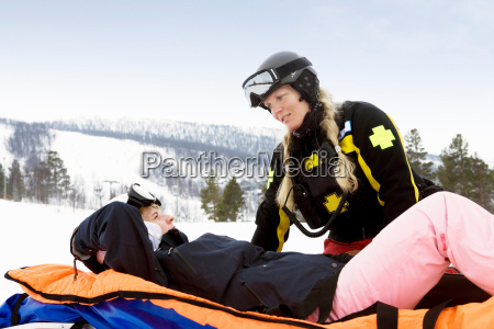 woman rescuer with skier