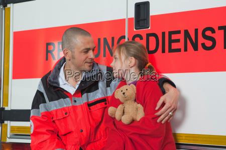 ambulance man caring about girl at