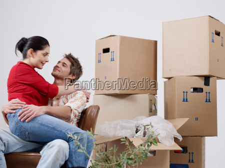 young couple between packing boxes