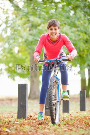 woman on a bike ready to