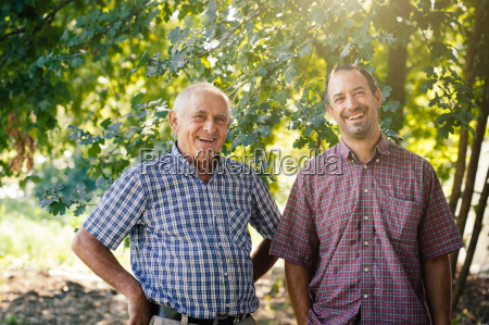 portrait of senior man and son