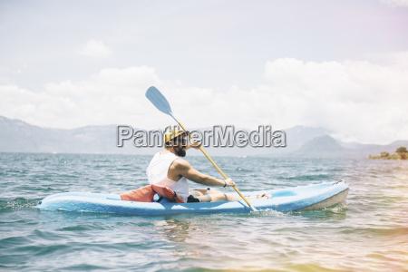 young man kayaking on lake