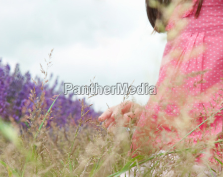 close up of girl in field