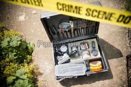 forensic toolkit at crime scene with