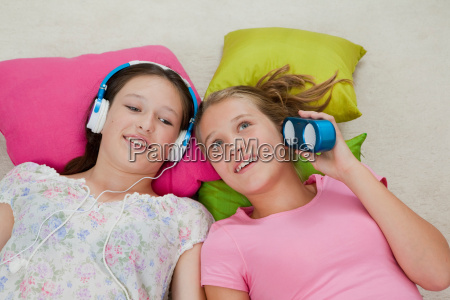 girls listening to music together