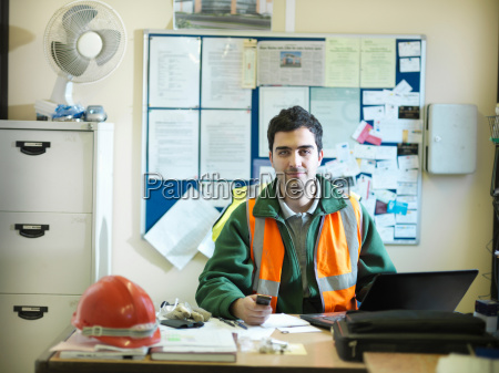 site foreman at desk in office