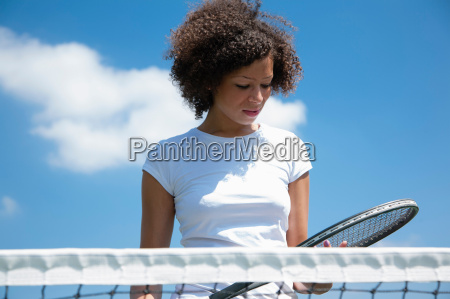 tennis player with racket on court
