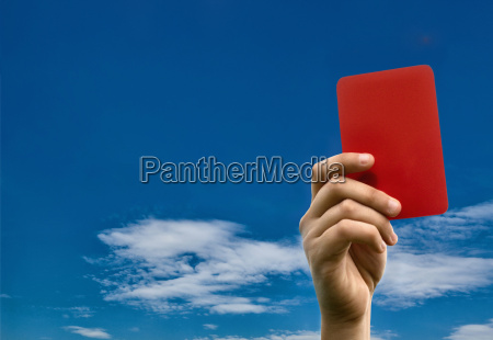 hand holding red card against blue