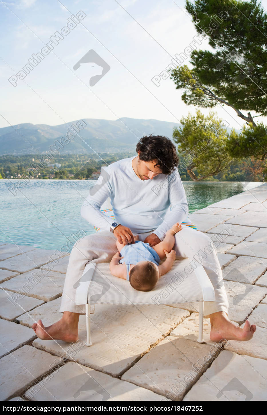 man, changing, a, baby's, diaper - 18467252